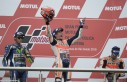 Spain's biker Marc Marquez (C) of Honda celebrates on the podium after winning the MotoGP race of the Argentina Grand Prix ahead of Italy's Valentino Rossi (L) of Yamaha and Spain's Dani Pedroza of Honda at Termas de Rio Hondo circuit, in Santiago del Estero, Argentina, on April 3, 2016.  AFP PHOTO / JUAN MABROMATA / AFP / JUAN MABROMATA