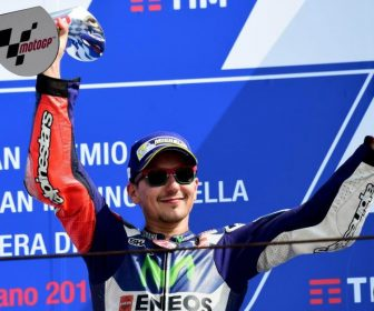 Movistar Yamaha MotoGP's Spanish rider Jorge Lorenzo celebrates his third place on the podium of the San Marino Moto GP Grand Prix race at the Marco Simoncelli Circuit in Misano, on September 11, 2016.  / AFP PHOTO / GIUSEPPE CACACE