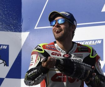 LCR Honda's British rider Cal Crutchlow celebrates his victory on the podium after the MotoGP race at the Australian Grand Prix at Phillip Island on October 23, 2016. / AFP PHOTO / SAEED KHAN / IMAGE RESTRICTED TO EDITORIAL USE - STRICTLY NO COMMERCIAL USE
