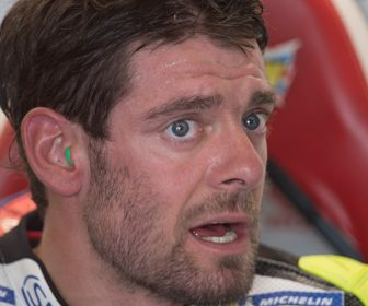 BRNO, CZECH REPUBLIC - AUGUST 04:   Cal Crutchlow of Great Britain and LCR Honda speaks in box during the MotoGp of Czech Republic - Qualifying at Brno Circuit on August 4, 2018 in Brno, Czech Republic.  (Photo by Mirco Lazzari gp/Getty Images)